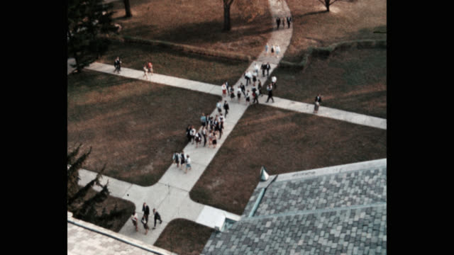 zoom out shot of students entering high school - zoom out stock videos & royalty-free footage