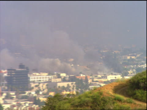 zoom out smoke over los angeles during riots - 1992 stock videos & royalty-free footage