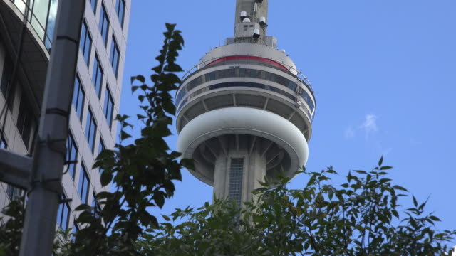 Zoom out the CN Tower or Canadian National Tower from King Street West The CN Tower is a major tourist attraction in Toronto