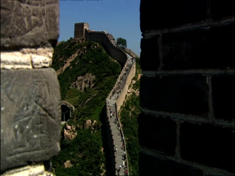 Zoom out then in to Great Wall of China, from battlement, Badaling, China