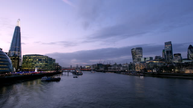 ws zoom out  time lapse night of the shard and river thames and city of london - gla building stock videos & royalty-free footage