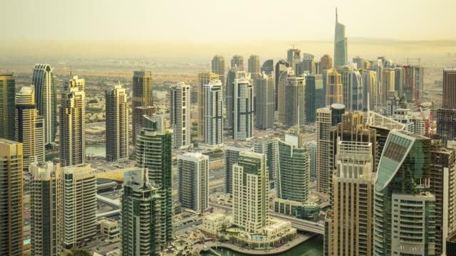 zoom out time lapse of dubai marina at dusk - wealth stock videos & royalty-free footage