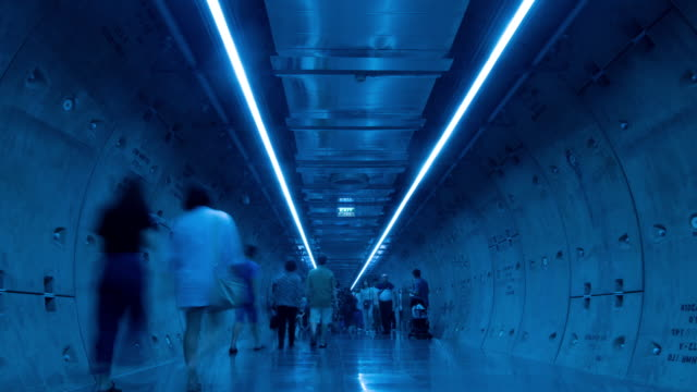 zoom out time lapse silhouette people in underground tunnel - short phrase stock videos & royalty-free footage