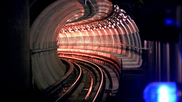 Zoom out time lapse subway train exiting tunnel towards camera / Los Angeles