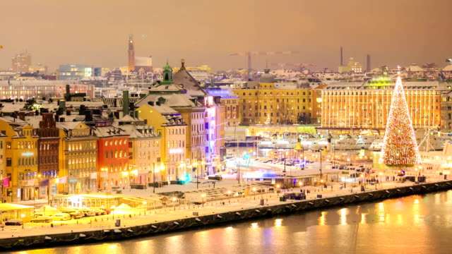 zoom out timelapse: stockholm cityscape at night - old town stock videos & royalty-free footage