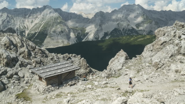 zoom out tl: a mountain hut on cloudscape view in a alps of austria at summer season, hafelekarspitze-seegrube at karwendel mountain,innsbruck austria - north tirol stock videos & royalty-free footage
