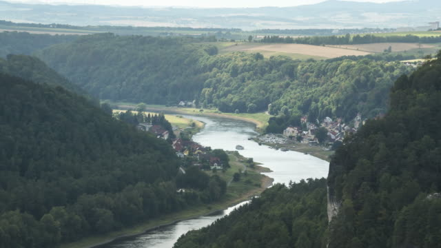 zoom out tl: city of wehlen and elbe near bastei rock in saxon switzerland along elbe river - hill stock videos & royalty-free footage