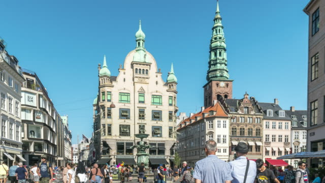 zoom out tl: market street and fountain on a central square in copenhagen, denmark - copenhagen video stock e b–roll
