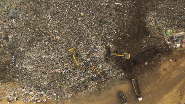 zoom out to large stack garbage dump in aerial view - rubbish stock videos & royalty-free footage