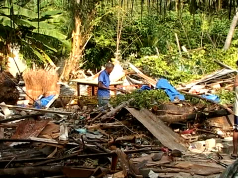 zoom out to ms man searching through rubble and debris caused by tsunami, maldives - 2004 stock videos & royalty-free footage
