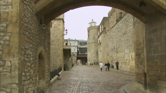 zoom out to wide shot of cobblestone street at tower of london - cobblestone stock videos & royalty-free footage
