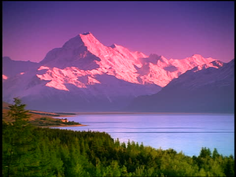 zoom out wide shot snow-covered mt. cook near lake pukaki / s. island / new zealand - zoom out stock videos & royalty-free footage