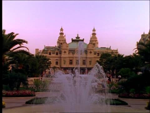 zoom out + zoom in of royal palace with fountain in front / monaco - royal palace monaco stock videos and b-roll footage