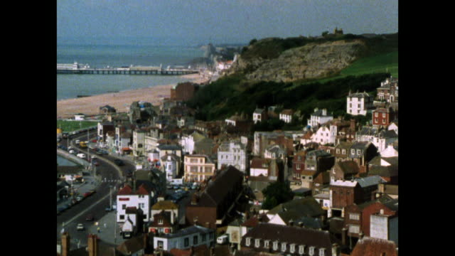 ha zoom over hastings seafront and beach; 1986 - rock face stock videos & royalty-free footage