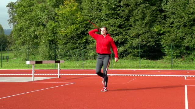 hd: zoom, shot of young woman throwing javelin - javelin stock videos & royalty-free footage