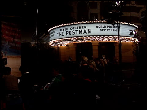 zoom the red carpet at the premiere of 'the postman' at warner theater in burbank, california on december 12, 1997. - zoom out点の映像素材/bロール