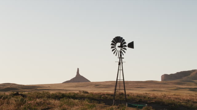Zoom with windmill and Chimney Rock in the background