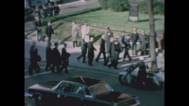 zoomed in view of priests entering cathedral of st. matthew the apostle for jfk's funeral service. views of other diginiataries entering the... - 使徒点の映像素材/bロール