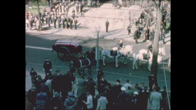zoomed in wide shots of john f. kennedy's flag draped coffin arriving in front of the cathedral of st. matthew the apostle for the funeral service - apostle stock videos & royalty-free footage