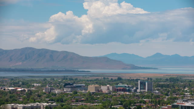 vidéos et rushes de zoomed time lapse view looking at downtown provo, utah - provo