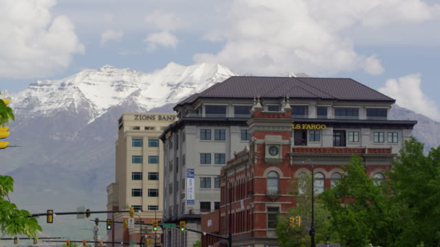 zoomed view of financial buildings towards timpanogos mountain - provo stock videos & royalty-free footage