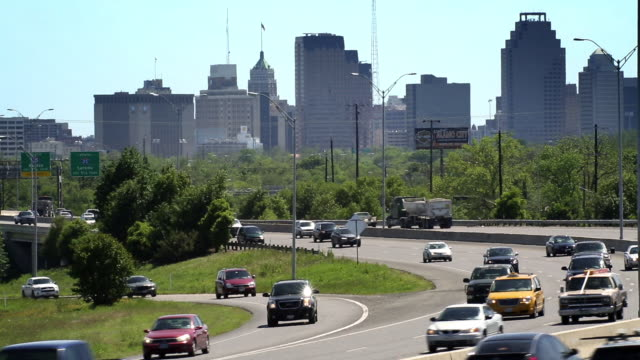 zoomed view of traffic on i-37 towards downtown san antonio. - san antonio texas stock videos and b-roll footage