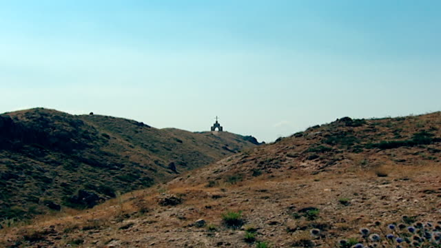 zoom-in of a christian shrine on top of a mountain of the northern mount lebanon range. - christentum stock-videos und b-roll-filmmaterial