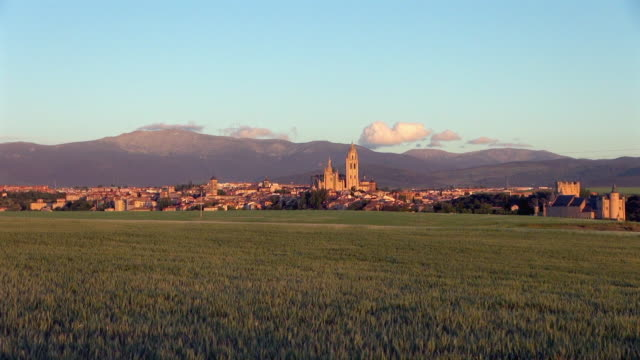 zoom-in of segovia grassland and cathedral in spain - segovia stock videos & royalty-free footage