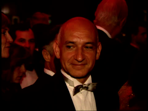zoomin on sir ben kingsley and geena davis talking on the red carpet at swifty lazar's oscar party - ben kingsley stock videos & royalty-free footage