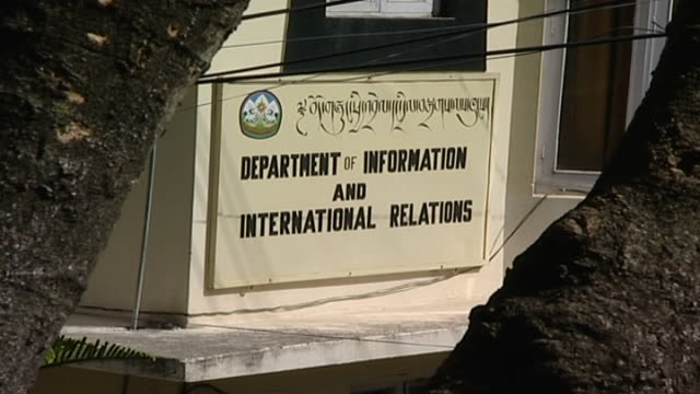 zoom-in on the sign for the department of information and international relations in dharamsala. - traditionally tibetan stock videos & royalty-free footage