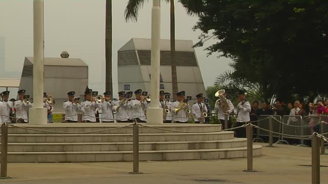 zoomin shot flag hoisting hong kong china - hoisting stock videos & royalty-free footage