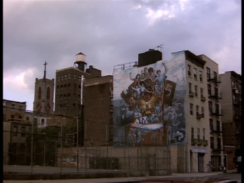 zoom-in to a basketball court in a low income new york neighborhood. - neighborhood street sign stock videos and b-roll footage