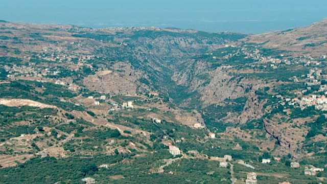zoom-in to a church from a view of the qadisha gorge in the northern mount lebanon range. - canyon stock videos & royalty-free footage