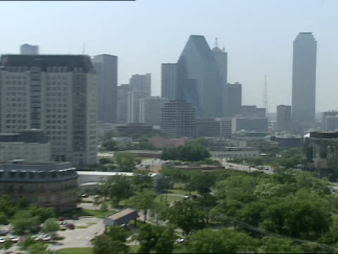 zooming by several lower buildings the focus is on the fountain place and bank of america plaza buildings in downtown dallas texas - bank of america stock videos & royalty-free footage