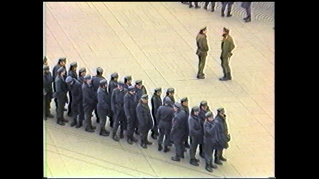 zooming in and out aerial view of policemen in uniform gathered at wenceslas square; people walking by on the sidewalk - czech republic stock videos & royalty-free footage