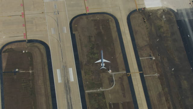 zooming in shot of an american airlines airplane taking off at the dallas fort worth international airport - directly above stock videos & royalty-free footage