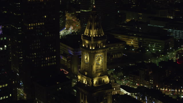 zooming in shot of the clock of the custom house tower at night - boston massachusetts stock videos & royalty-free footage