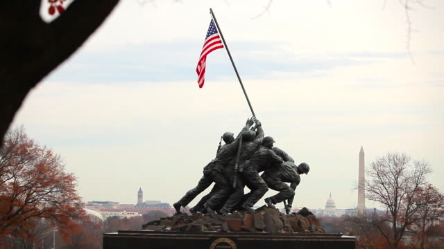 A zooming in shot of the Marine Corps War Memorial.
