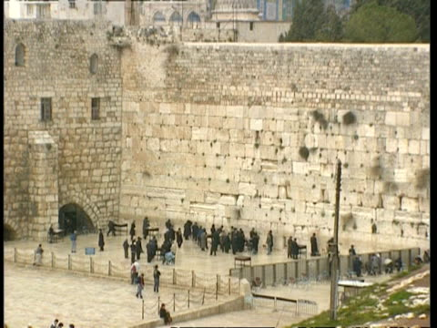 wa zooming in, wailing wall with devout jews praying, jerusalem - wailing wall stock videos & royalty-free footage