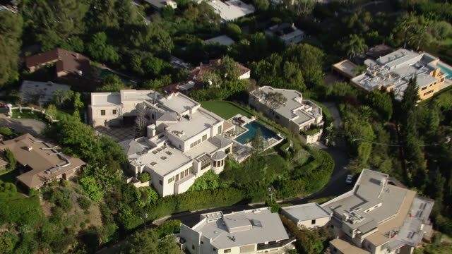 los angeles, california - march 30, 2011: zooming out from hollywood hills mansions. - villa stock videos & royalty-free footage