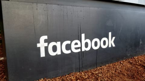 zooming out from text reading facebook on the main sign at headquarters of social media company facebook, in the silicon valley, menlo park,... - headquarters stock videos & royalty-free footage