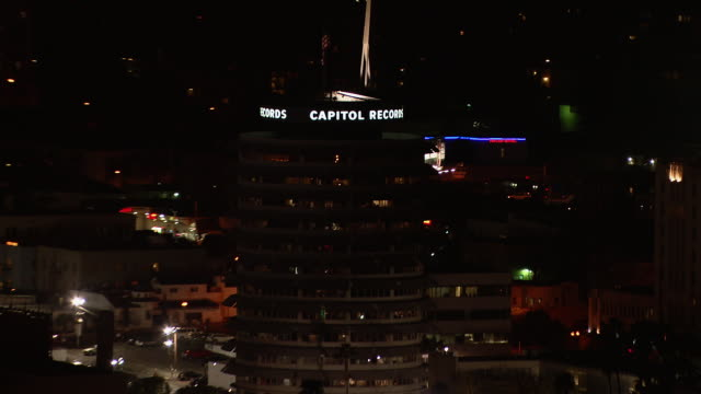 Zooming out from the Capitol Records Tower to a view of Hollywood at night.