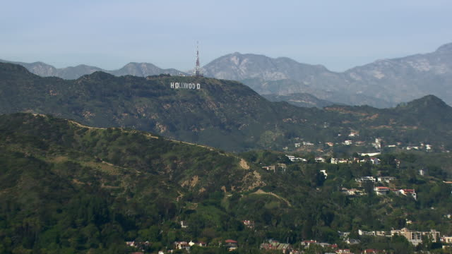 zooming out from the famous hollywood sign to a scenic view of hollywood, los angeles. - hollywood sign stock videos & royalty-free footage