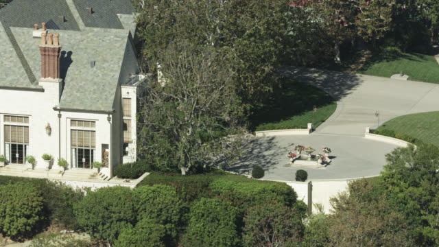 zooming out shot of a mansion in the hills above brentwood - brentwood los angeles stock videos & royalty-free footage