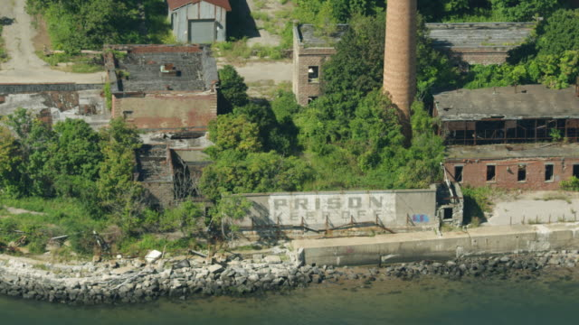 zooming out shot of a prison sign on hart island - hart island stock videos & royalty-free footage