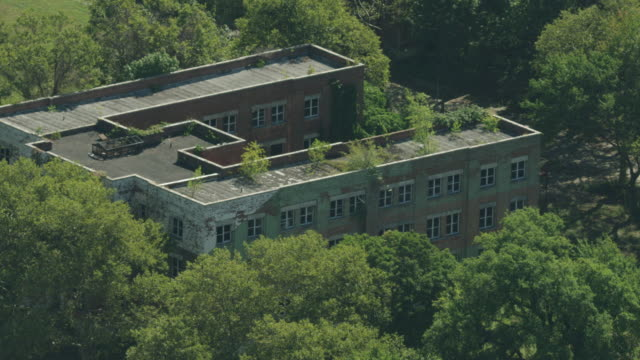 zooming out shot of an abandoned building on hart island - hart island stock videos & royalty-free footage