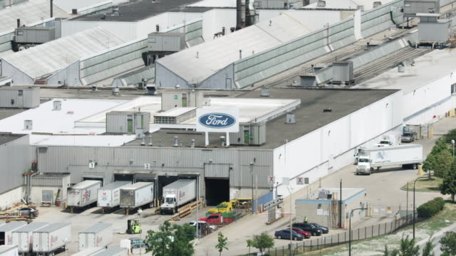 zooming out shot of loading bays at the ford chicago assembly plant - ford motor company stock videos & royalty-free footage