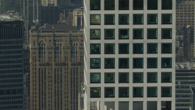 Zooming out shot of maintenance staff working at the 432 Park Avenue