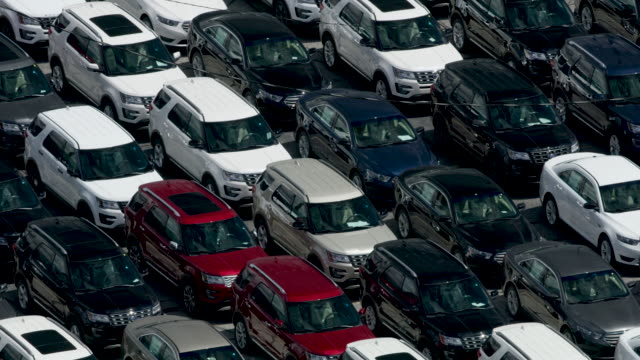 zooming out shot of new fords parking in the ford chicago assembly plant - ford motor company stock videos and b-roll footage