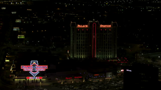 zooming out shot of palace station hotel in las vegas at night - casino night stock videos & royalty-free footage